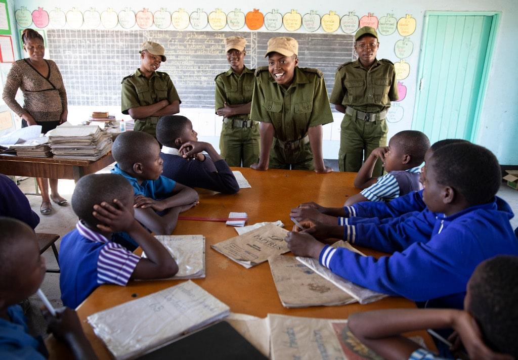 Akashinga Rangers speaking to students in classroom