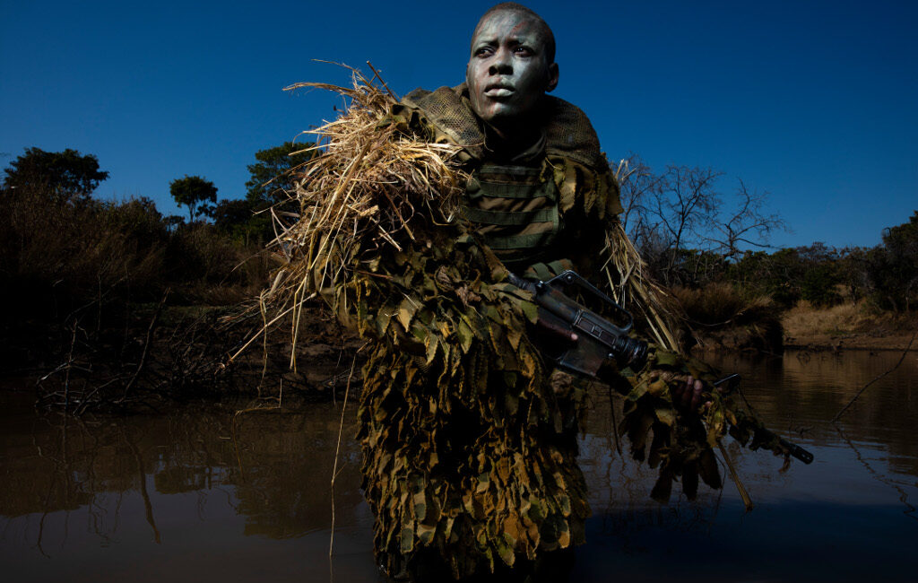 Akashinga Ranger in camouflage in field