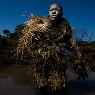 Akashinga Ranger in camouflage in field