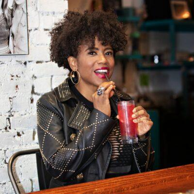 Jacque Reid drinking beverage