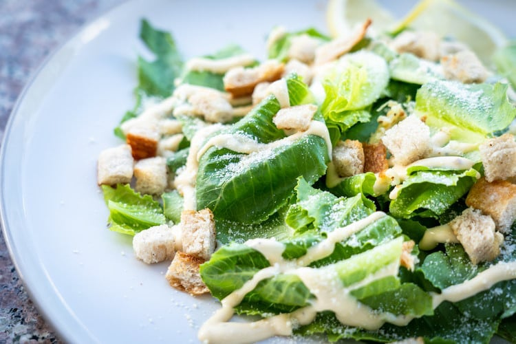 Salad on a plate with dressing